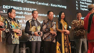 Bupati Batanghari Terima Penghargaan API Award Tahun 2019
