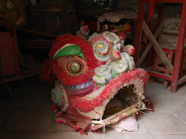 head of a red traditional Chinese lion costume
