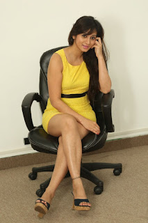 Harshika Poonacha Stills in Yellow Short Dress at Appudala Ippudila Movie Promotions ~ Celebs Next