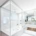 Banheiro contemporâneo todo branco com banheira integrado ao closet!