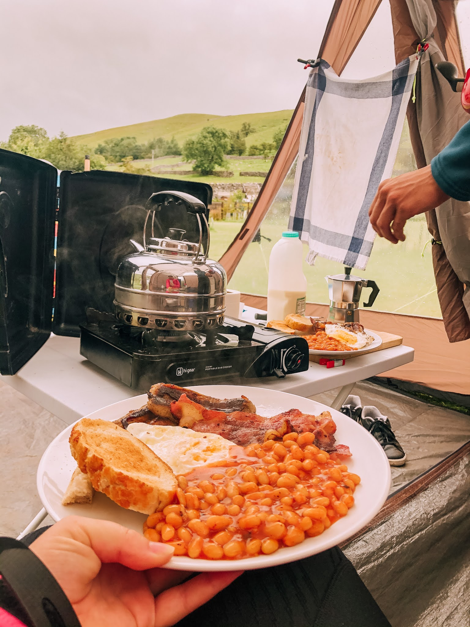 full english breakfast in a tent
