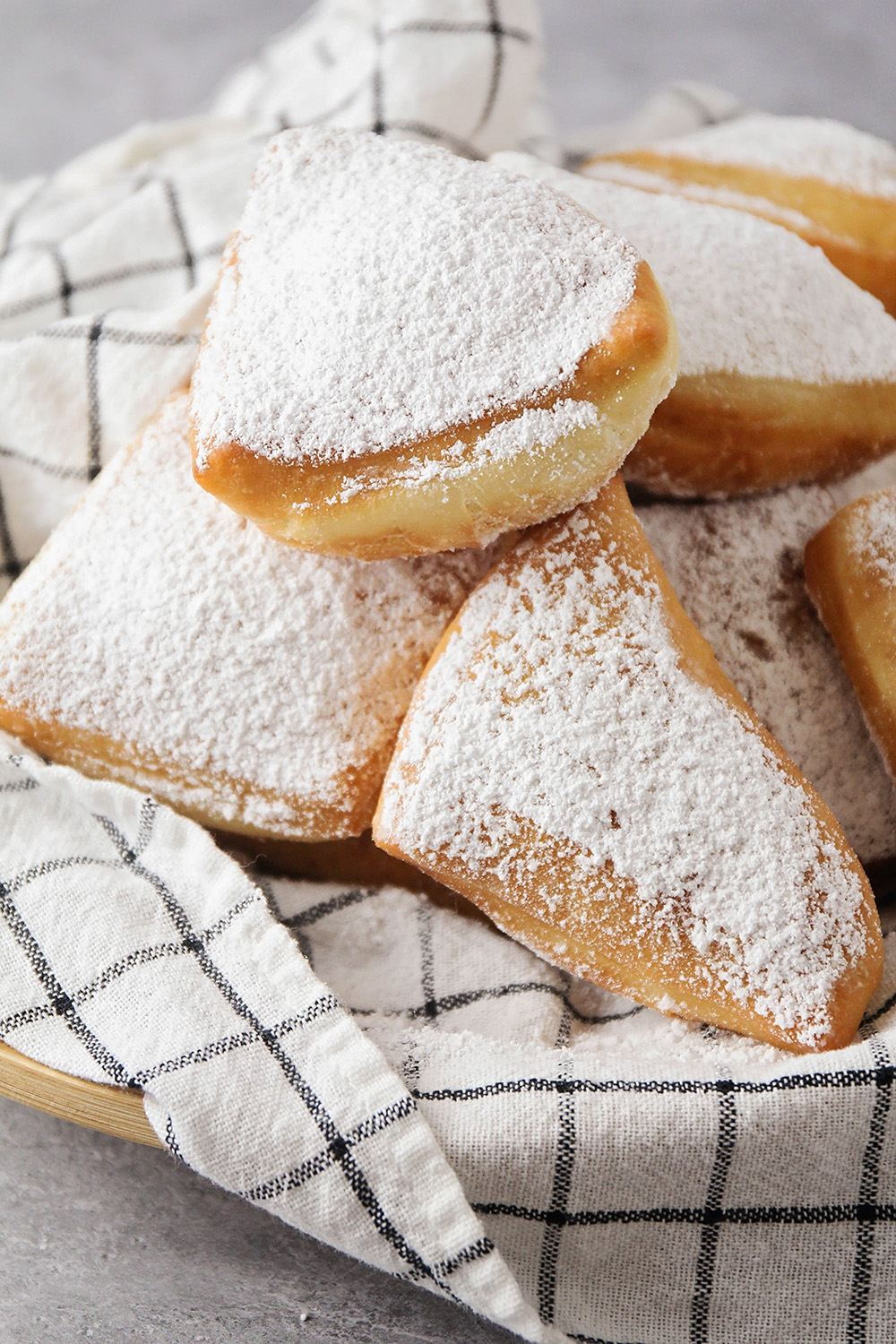 These easy homemade beignets are absolutely divine! They're light and fluffy, with the perfect amount of sweetness. So delicious and easy to make!