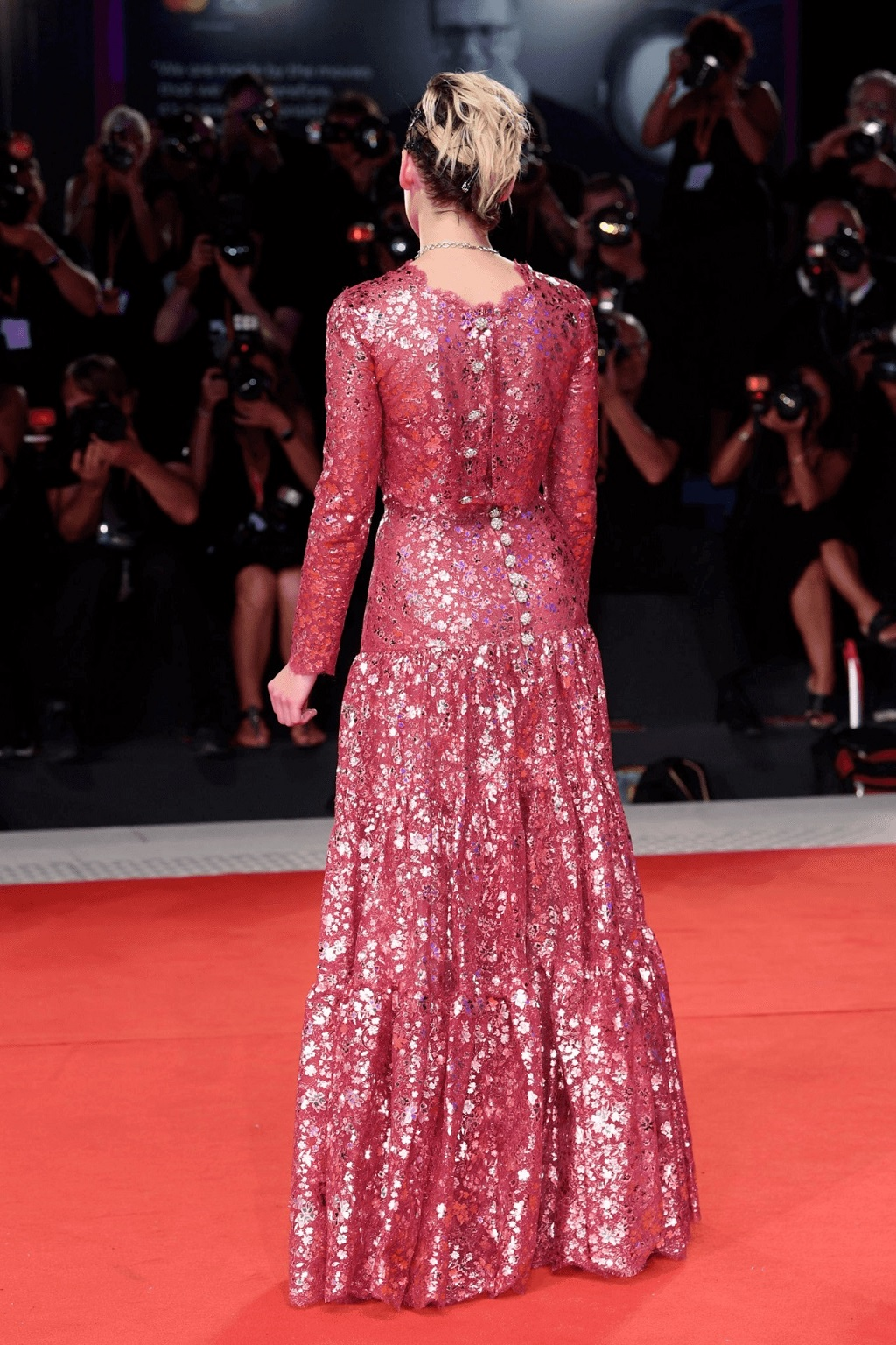 Kristen Stewart dazzles on the red carpet in a fuchsia dress at Seberg premiere