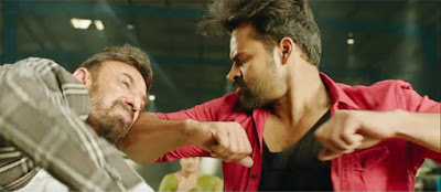 Inttelligent (2018) is an Indian Telugu action film directed by V.V. Vinayak in 2018. The film is starred by Sai Dharam Tej in the lead role.    Sai Dharam Tej and Lavanya Tripathi in Inttelligent (2018) movie   Only one person has been seen in the lead role. Lavanya Tripathi is the heroine everyone would think. But there is no lead role of her in the movie. But there are some songs in which she is seen with Sai Dharan Tej as the pair. In some other antagonist and protagonist important roles, Nassar, Ashish Vidyarthi, Sayaji Shinde, Rahul Dev, Dev Gill, Vineet Kumar and others played have played them. Besides, Posani Krishna Murali, Brahmanandam, Jaya Prakash Reddy have played in some comedy roles. Overall it is a good story. Most of the movies made based on real life incidents have been successful in the box office both in Bollywood or South India. But it becomes a commercial failure and receives many negative critical reviews. Tej's former three films have been flopped and Inttelligent also. It is made based on a real life story. The story is really actionable but there is something lack. Audiences sometimes find emotion of every character. If they find that, they think it is the best.   Sai Dharam Tej and Rahul Dev in Inttelligent (2018) movie    Film making style is something different from other director with a routine story. The first half of the movies goes with intelligence (brain) but the last half goes with brawn that means action. And the action is unilateral. Though there are some movies in which partial characterization has been done. But in action film like this partial power is the main.  Dharam Tej from childhood had dream to be a software engineer to stay with his mentor Nadha Kishore, the Managing Director of an IT company. But through the help of home minister, illegally, Vicky Bhai occupies on his company and murders him. After that, Dharam Tej turn into Dharma Bhai and his first step was to transfer money from all local villains which he distributed to the poor and orphans. He with the help of his friends (colleagues) kills Minister's son and all henchmen of Vicky Bhai. At the last scene, taking sign on the document of the IT Company, he kills Vicky Bhai, minister and rescues his parents and others.   Sai Dharam Tej in an action Scene in Inttelligent (2018) Movie    It is very common and routine story though it is based on a real life story. But keeping the hero in the center can be an idea of the director. From this perspective, it is different from other film. I read some reviews and criticism about this film but got negative reviews from most of the critics. Adjustment in all sectors of film making is very tough. Nevertheless, Inttelligent is the hope to make next film blockbuster.     Watch the full movie 'Inttelligent' (2018) here...
