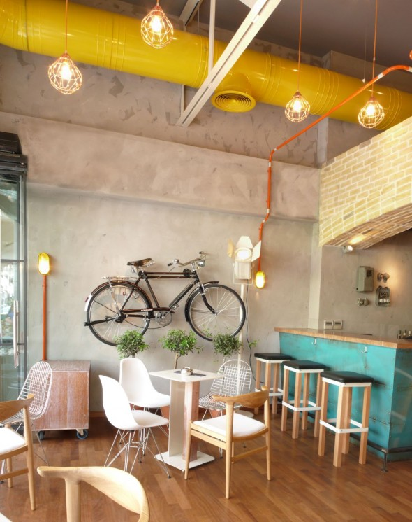This retro bike adds a nice touch to this modern coffee shop wall
