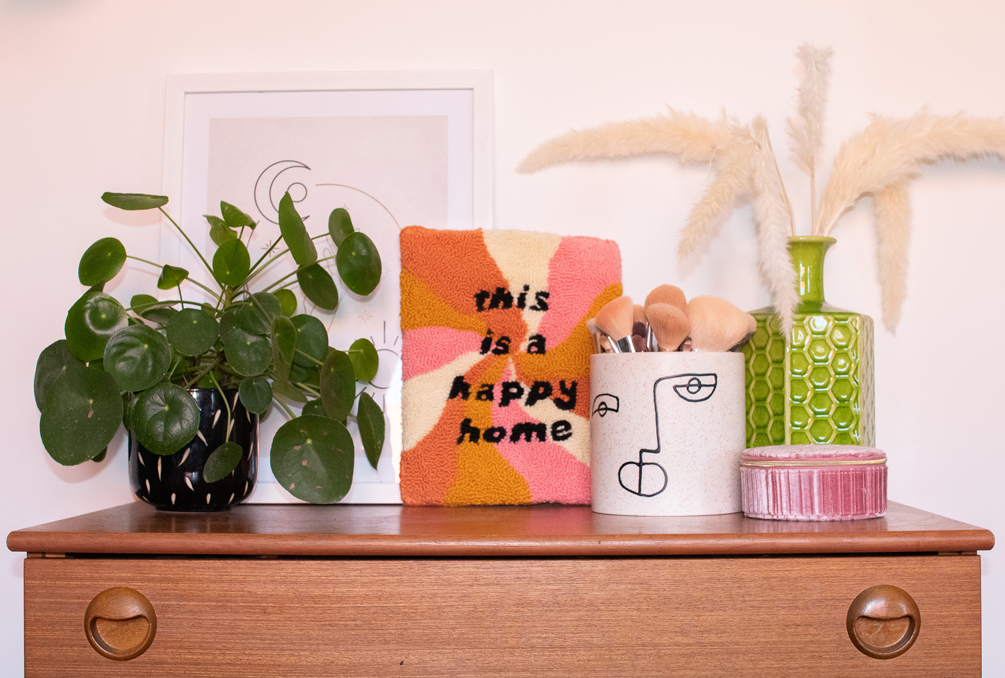 """""""this is a happy home"""" punch needle tufted wall hanging styled in colourful mid century interiors home"""