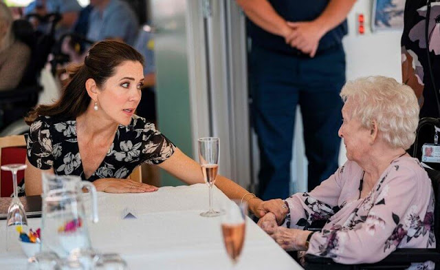 Crown Princess Mary wore a new floral wrap dress from Ralph Lauren, and Gianvito Rossi pumps, Dulong Esme bracelet, Cartier Love Bracelet