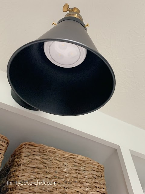 sconce with puck lights