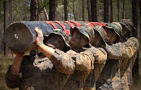 Recruits carry a log