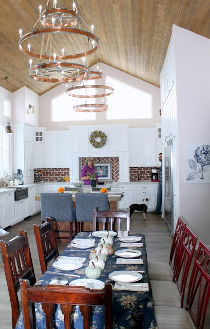 Kitchen with white kitchen and wood ceiling
