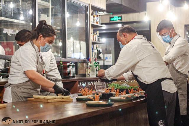 Chef James Antolin preparing dishes in Ikomai Tochi