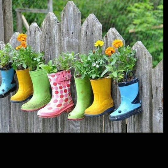 These boot planters hung against the fence are a quirky outside addition.