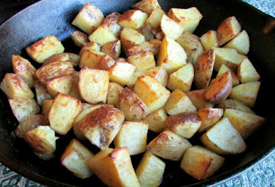 golden roasted potatoes in skillet