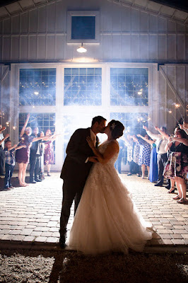bride and groom kiss at sparkler exit