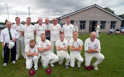 The Brigg Town Cricket Club team which played Broughton on July 6, 2019 with umpire Patrick Taylor on the left