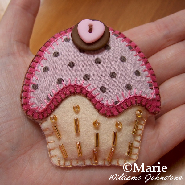 Pink and brown felt and fabric cupcake brooch pin with button and bead details