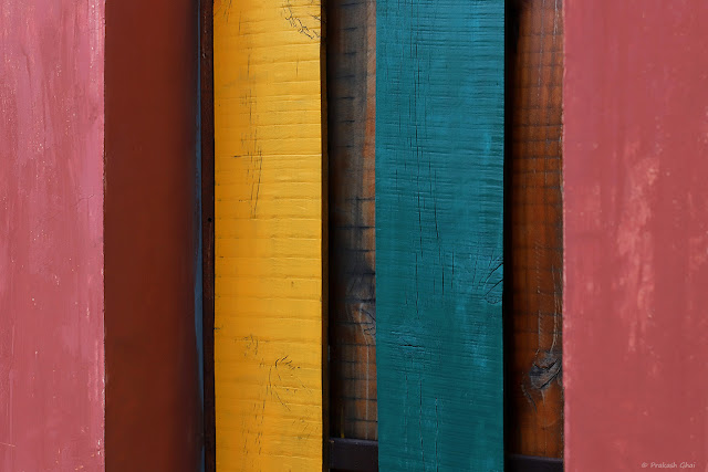 A Colorful Minimal Art Photograph of Multi colored stripes of painted Wood.