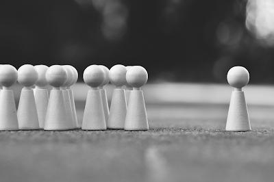 Wooden pawns. Free image via Pixabay.