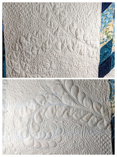 Adding plumes to fill the corner blocks with more free motion feather quilting