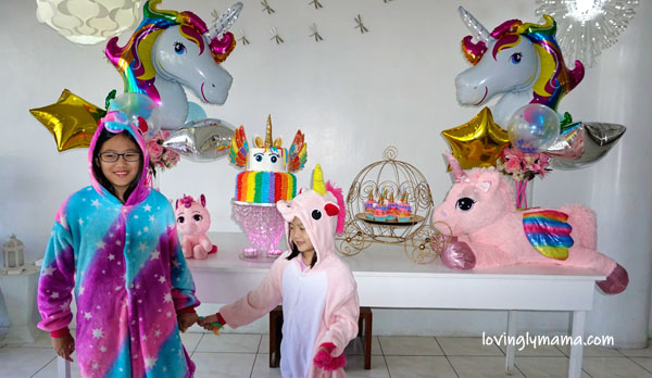unicorn girl - unicorn onesies- unicorn cake - rainbow unicorn cake - unicorn cupcakes - 6th birthday pictorial - Bacolod Cupcake Cafe - unicorn foil balloons - Bacolod mommy blogger - birthday party - unicorn costumes