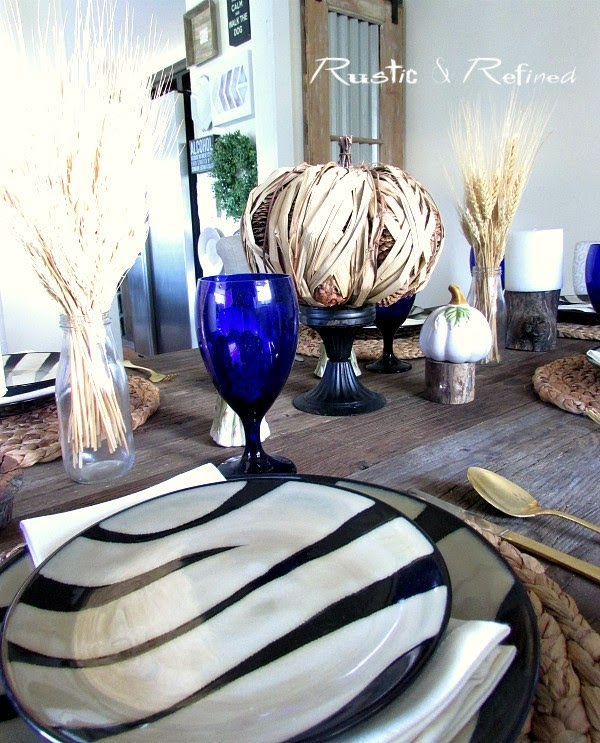 Quick and easy tablescape using zebra striped dishes for great fall texture.