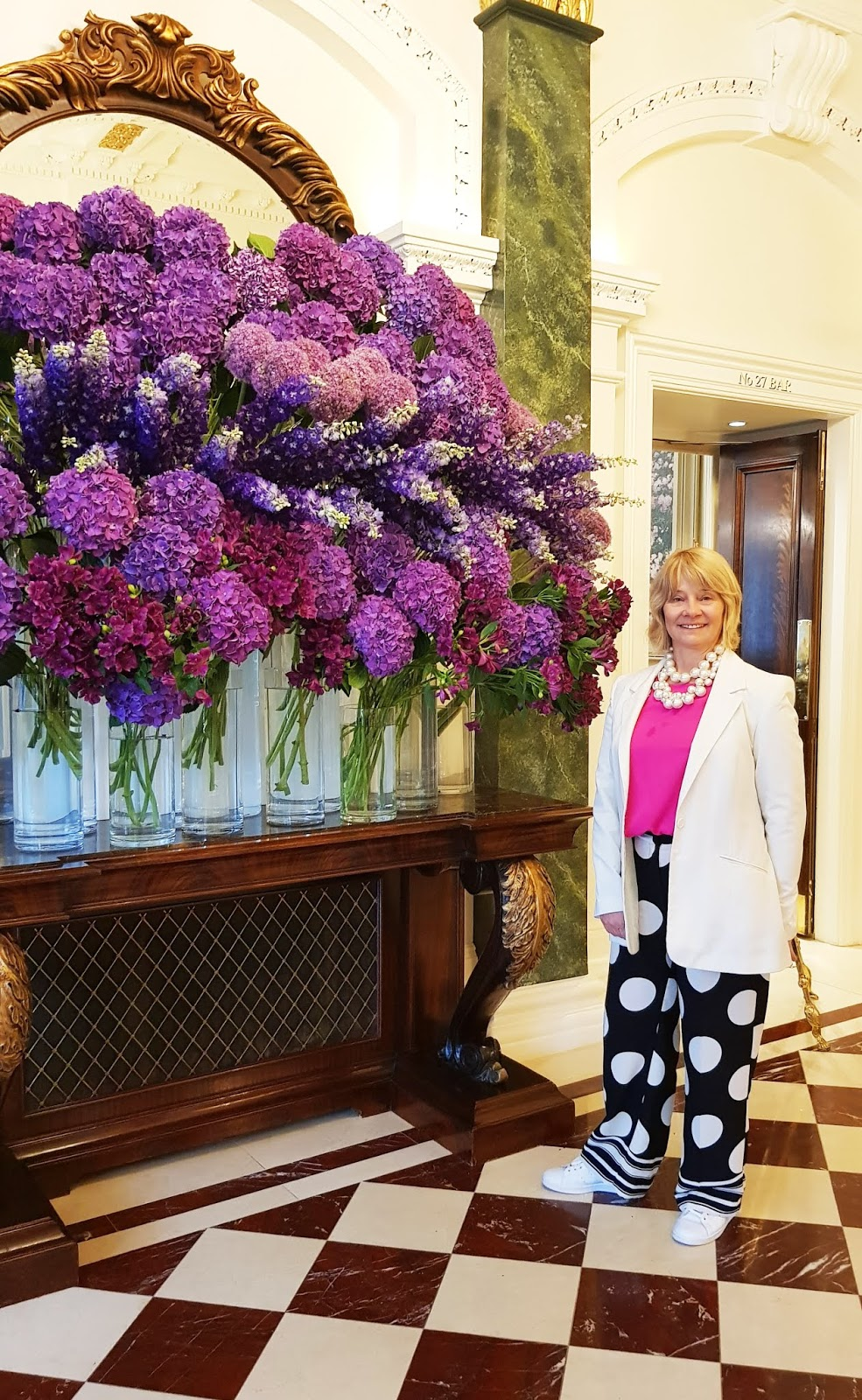 Posing by beautiful hydrangeas Gail Hanlon from Is This Mutton fashion blog