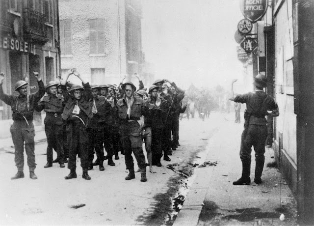 Canadian POWs being led through Dieppe by German soldiers during WWII.
