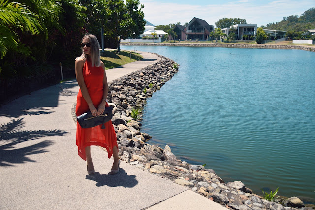 orange midi dress in tropical paradise lake