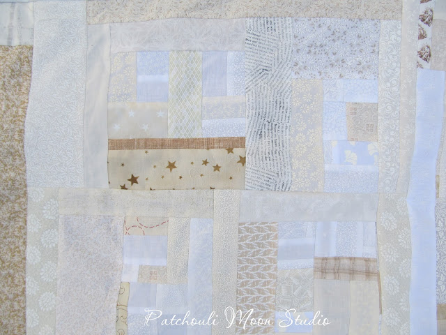 closeup of Scrappy pieced background fabric for table runner in white and off white fabrics