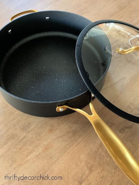 pretty black and brass pots and pans