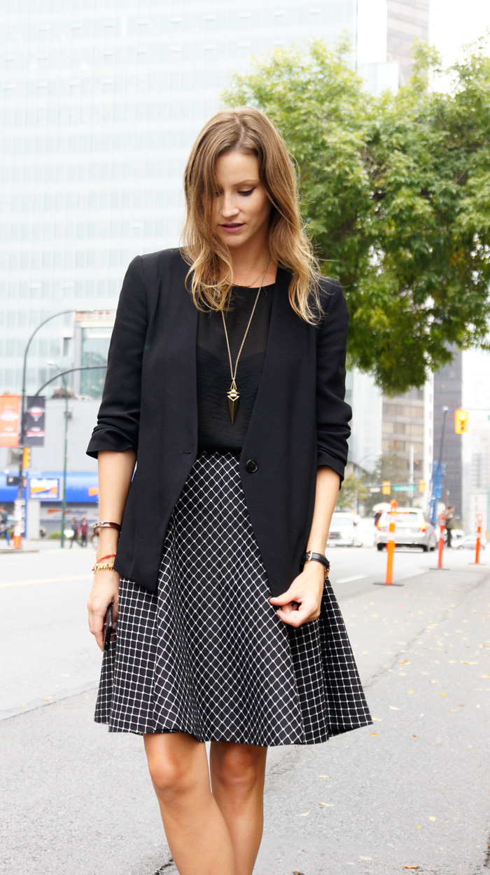 Vancouver Fashion Blogger, Alison Hutchinson, is wearing a Club Monaco Midi skirt, Zara black top and blazer, and Sam Edelman Boots