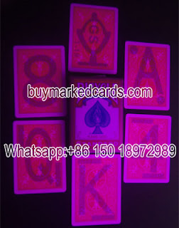 luminous ink marked playing cards
