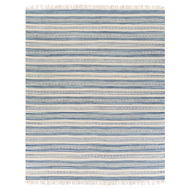 I love farmhouse style, the color blue, and cushy rugs! Here are ten of my favorite blue rugs. All of them perfect for creating that farmhouse style! This one is striped with fringe.