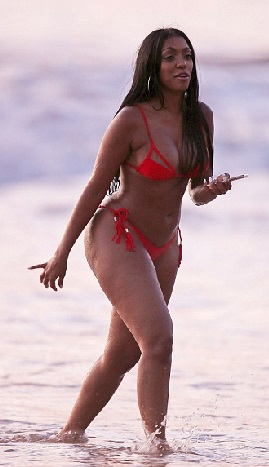 Image result for Porsha Williams Puts Her Stunning Curves On Full Display In A Bold Red Bikini