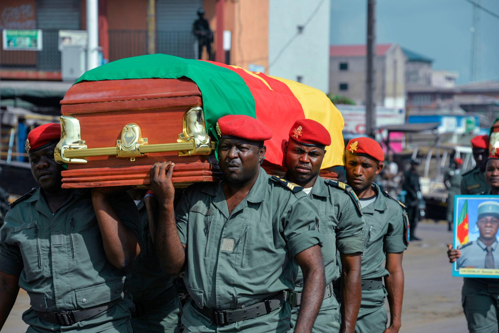 Soldiers carry the coffin of one of the four soldiers killed in the violence that erupted in the Northwest and Southwest regions of Cameroon in Bamenda on Nov. 17, 2017. AFP VIA GETTY IMAGES