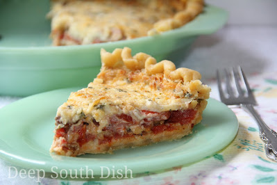 Tomato pie, using simple fresh ingredients - juicy tomatoes and fresh herbs, layered in a flaky pie crust, with sweet onion and cheese. Dress the top with the traditional mayonnaise and cheese mixture, and you've got a classic southern tomato pie.