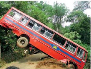 Bus dips 300 feet into precipice when driver is engaged in telephone call ... 2 dead, 63 hospitalised!