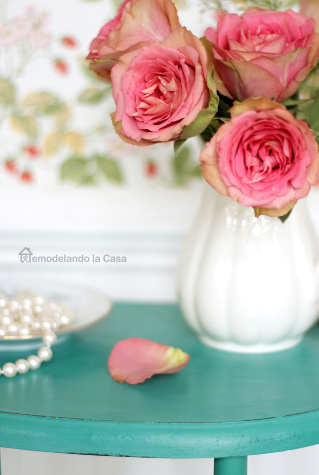 Pink roses in white pitcher, white beadboard, pearls