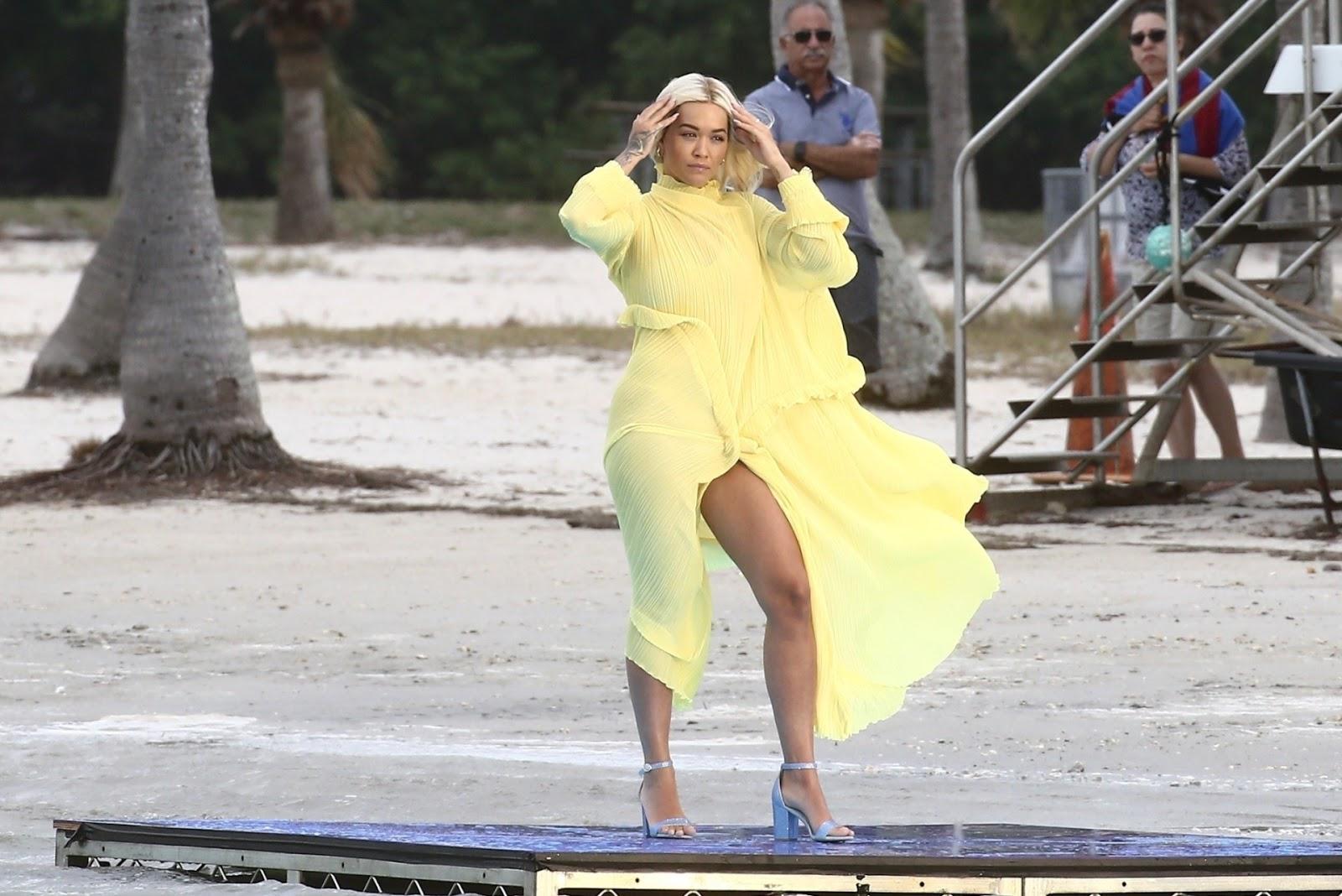 Rita ora having wardrobe malfunction exposing her panties on beach in Miami.