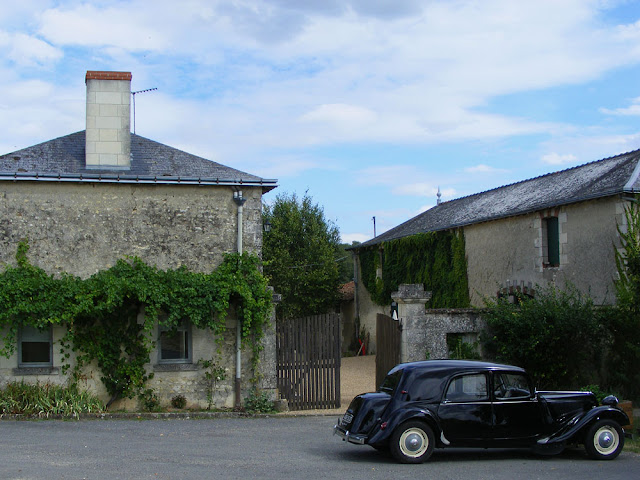 Citroen Traction Avant car outside a winery.  Indre et Loire, France. Photographed by Susan Walter. Tour the Loire Valley with a classic car and a private guide.