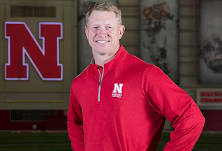 Scott Frost posing for picture