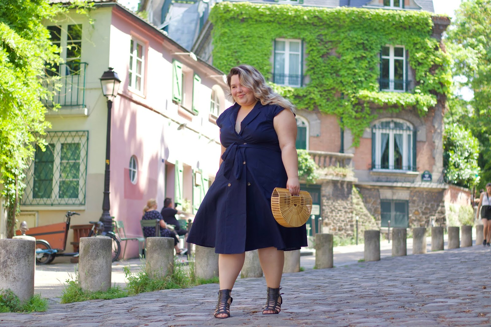 Chicago Plus Size Petite Fashion Blogger, influencer, YouTuber, and model Natalie Craig, of Natalie in the City, wears City Chic's fit and flare midi dress from Dia & Co while visiting this cute pink restaurant, La Maison Rose in Paris, France.
