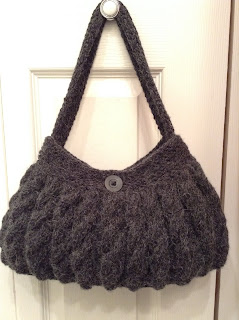 Bag is knitted with cables