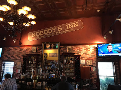 """Nobody's Inn... Mahwah, New Jersey... now called Roxanne's with the original """"Nobody's Inn"""" sign hanging on the wall."""