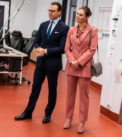 Princess Victoria wore Rodebjer pink suit, blazer and trousers. Rodebjer Xilla silk blouse. Dulong, Kreuger Jewellery pink earrings