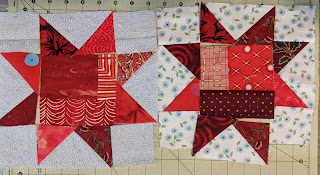 The centers squares of  these Sawtooth Star blocks are composed of red scraps of fabric.