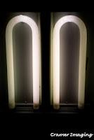 Cramer Imaging's photograph of two flourescent lights without covers on the ceiling