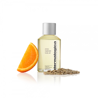 bottle of dermalogica-phyto-replenish-body-oil with bergamot seeds and orange slice