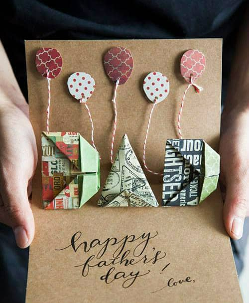 hands displaying Father's Day card featuring paper balloons on baker's twine strings and patterned paper pop up origami DAD letters