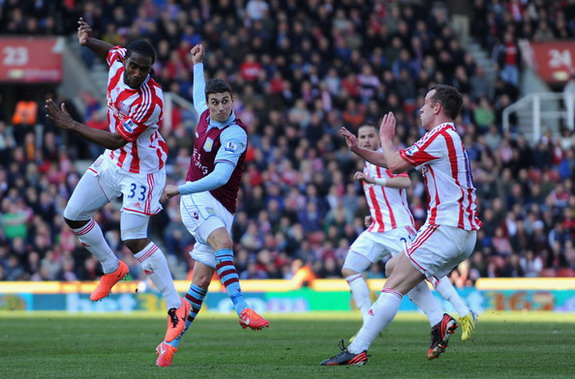 Aston Villa player Matthew Lowton scores his team's second goal against Stoke